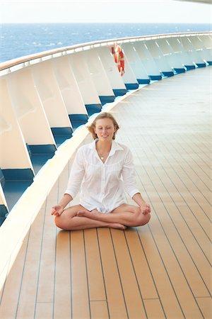 Teenage Girl Meditating on Cruise Ship Deck Stock Photo - Rights-Managed, Code: 700-06190529