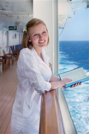 Teenage Girl Reading Book on Cruise Ship Stock Photo - Rights-Managed, Code: 700-06190531