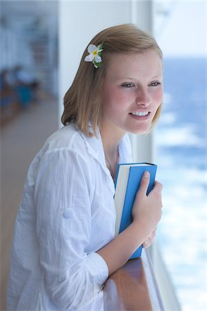 Teenage Girl with Book on Cruise Ship Stock Photo - Rights-Managed, Code: 700-06190532
