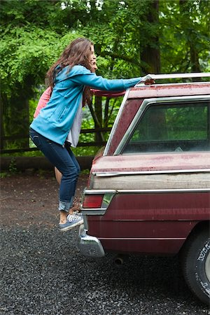 female rear end - Teenage Girls Hanging on to Back of Car Stock Photo - Rights-Managed, Code: 700-06190615