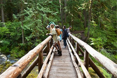 Group of People on Rustic Bridge Stock Photo - Rights-Managed, Code: 700-06190646