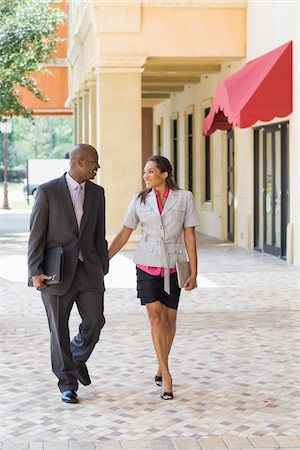 Business Couple Holding Hands Stock Photo - Rights-Managed, Code: 700-06282124
