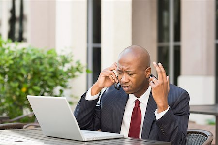 Stressed Businessman with Laptop and Cell Phone Stock Photo - Rights-Managed, Code: 700-06282144