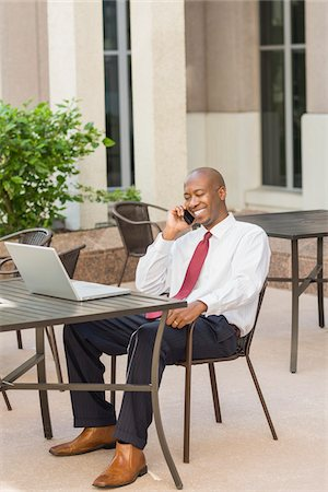 Businessman with Laptop and Cell Phone Stock Photo - Rights-Managed, Code: 700-06282145