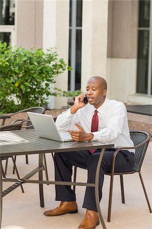 Businessman with Laptop and Cell Phone Stock Photo - Rights-Managed, Code: 700-06282146