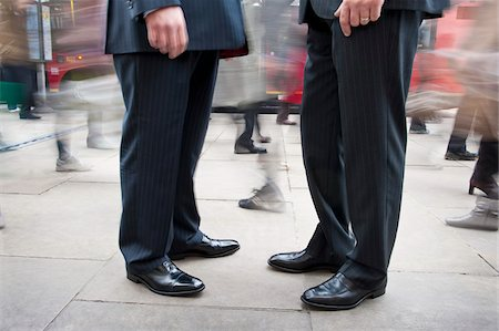 Two Businessmen Standing Amongst Pedestrian Traffic Stock Photo - Rights-Managed, Code: 700-06325341