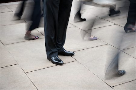 Businessman Standing Still Amongst Pedestrian Traffic Stock Photo - Rights-Managed, Code: 700-06325342