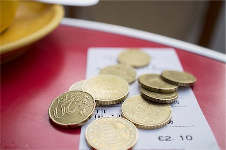 Euro Coins and Restaurant Bill on Table in Parisian Cafe Stock Photo - Rights-Managed, Code: 700-06334356