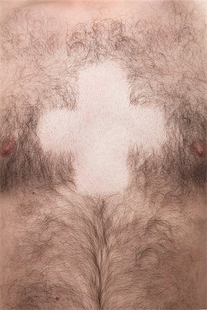 Bare Cross Shape in Man's Chest Hair Stock Photo - Rights-Managed, Code: 700-06334359