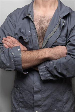 Close-Up of Man Wearing Coveralls Stock Photo - Rights-Managed, Code: 700-06334364