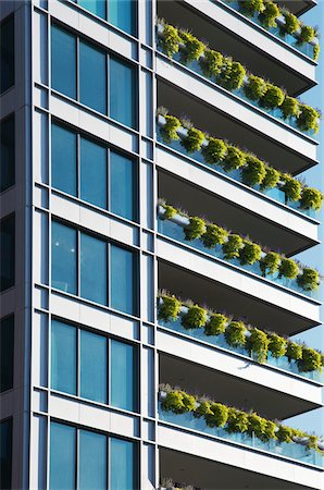 residential - New Condominiums with Hanging Flower Baskets on Balconies Stock Photo - Rights-Managed, Code: 700-06334553
