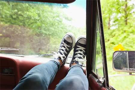 Woman's Feet on Dashboard of Car Stock Photo - Rights-Managed, Code: 700-06334619