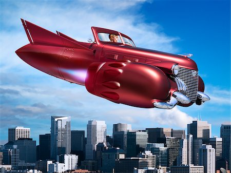 fantastically - Woman Flying Jet Car over City Stock Photo - Rights-Managed, Code: 700-06368055