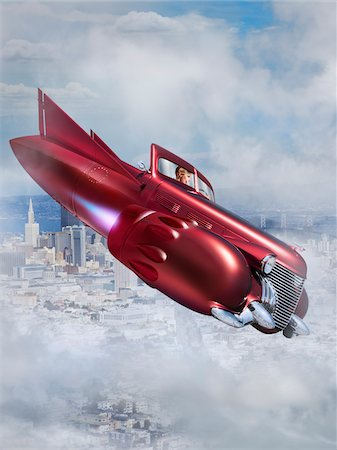 fantastically - Woman Flying Jet Car over City Stock Photo - Rights-Managed, Code: 700-06368057