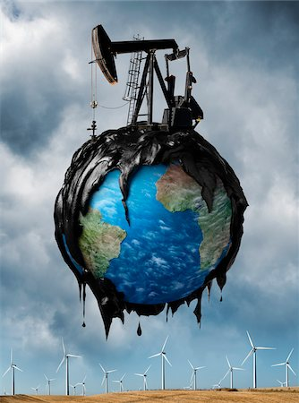 Oil Covered Globe Hovering over Wind Farm Stock Photo - Rights-Managed, Code: 700-06368067