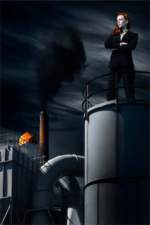 refinery - Businesswoman Standing on top of Industrial Building at Night Stock Photo - Rights-Managed, Code: 700-06368063