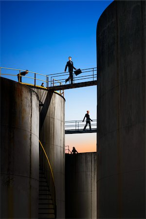 refinery - Businesspeople Walking Across Catwalks Between Storage Tanks Stock Photo - Rights-Managed, Code: 700-06368073