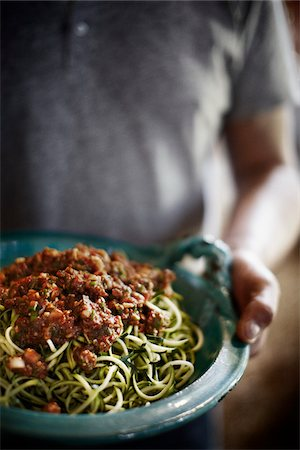 delicious - Man Carrying a Bowl of Shredded Zucchini with Meat Sauce Stock Photo - Rights-Managed, Code: 700-06383019