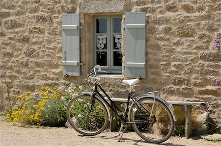 Bicycle Parked by Window and Bench Stock Photo - Rights-Managed, Code: 700-06383061