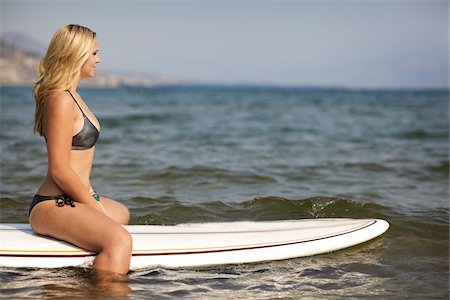 Surfer Floating on Surfboard Stock Photo - Rights-Managed, Code: 700-06383764
