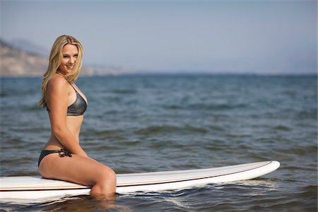 Surfer Sitting on Surfboard Stock Photo - Rights-Managed, Code: 700-06383763