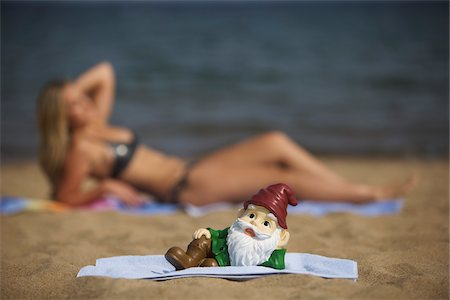dwarf - Garden Gnome Posing on Beach Stock Photo - Rights-Managed, Code: 700-06383797