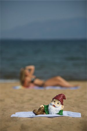 dwarf - Garden Gnome Posing on Beach Stock Photo - Rights-Managed, Code: 700-06383798