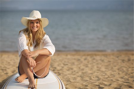Portrait of Woman Sitting on Surfboard Stock Photo - Rights-Managed, Code: 700-06383791