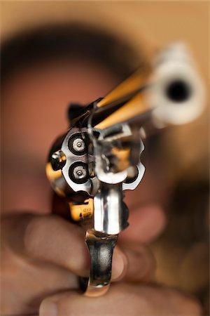 Close-Up of Man Aiming Gun Stock Photo - Rights-Managed, Code: 700-06383819