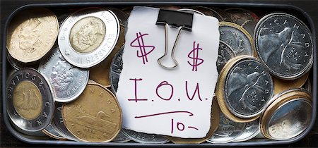 quarter note - IOU Note in Tin of Loose Change Stock Photo - Rights-Managed, Code: 700-06383841