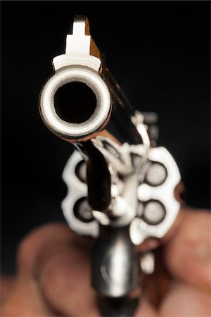 Close-Up of Man Aiming Gun Stock Photo - Rights-Managed, Code: 700-06383880