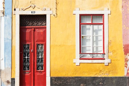 Close-Up of Brightly Painted Home, Algarve, Portugal Stock Photo - Rights-Managed, Code: 700-06397576