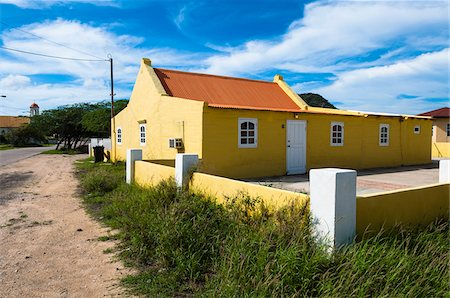 residential - Yellow House with Fenced Courtyard, Aruba, Leeward Antilles, Lesser Antilles, Caribbean Stock Photo - Rights-Managed, Code: 700-06439069