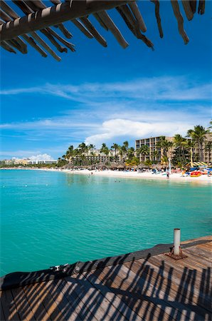 palm - View of Resort Beach from Pelican Pier, Palm Beach, Aruba, Leeward Antilles, Lesser Antilles, Caribbean Stock Photo - Rights-Managed, Code: 700-06439063