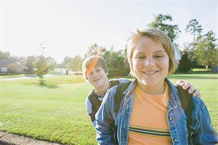 Portrait of Two Boys Standing Outdoors in Neighbourhood Area Stock Photo - Rights-Managed, Code: 700-06439144