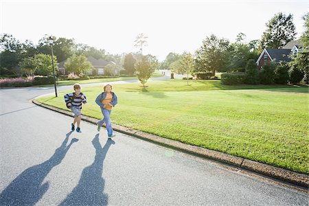street - Two Boys Running on Neighbourhood Street on Way to School Stock Photo - Rights-Managed, Code: 700-06439146