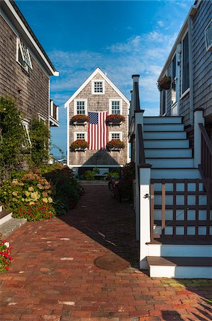Historic Fisherman's Shingle House Draped with American Flag, Provincetown, Cape Cod, Massachusetts, USA Stock Photo - Rights-Managed, Code: 700-06431210
