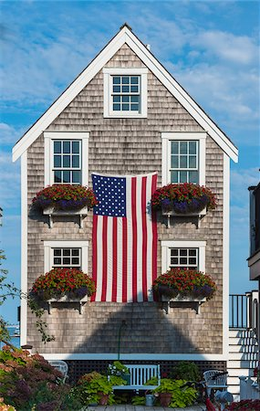 quaint house - Historic Fisherman's Shingle House Draped with American Flag, Provincetown, Cape Cod, Massachusetts, USA Stock Photo - Rights-Managed, Code: 700-06431211