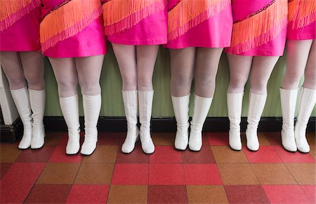 Waist Down View of Six Women Dressed in Vintage Pink Dresses and White Go-go Boots Standing in a Row on Checkered Floor Stock Photo - Rights-Managed, Code: 700-06431315