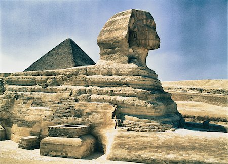 Sphinx with Pyramid of Khufu in Background, Giza, Egypt Stock Photo - Rights-Managed, Code: 700-06431337