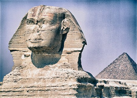 Close-up of Sphinx with Pyramid of Khufu in Background, Giza, Egypt Stock Photo - Rights-Managed, Code: 700-06431338