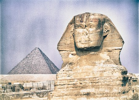 Close-up of Sphinx with Pyramid of Menkaure in Background, Giza, Egypt Stock Photo - Rights-Managed, Code: 700-06431341