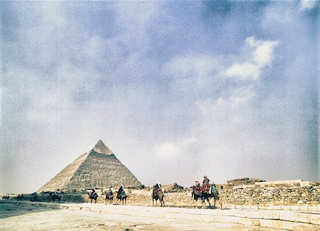 egypt - Bedouins Riding Camels with Khafre Pyramid in Distance, Giza, Egypt Stock Photo - Rights-Managed, Code: 700-06431342