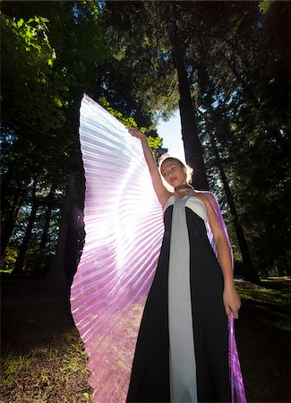 Girl with Outstretched Fairy Wings with Sun Shining from Behind Stock Photo - Rights-Managed, Code: 700-06431494