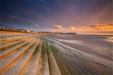 europe - Seafront Steps and Defense Walls with South Pier and Pleasure Beach in the Background at Dusk, Blackpool, Lancashire, England Stock Photo - Rights-Managed, Code: 700-06452038