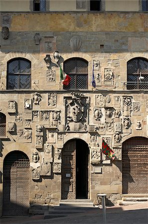carved stone facade of Palazzo Pretorio, Arezzo, Province of Arezzo, Tuscany, Italy Stock Photo - Rights-Managed, Code: 700-06452059