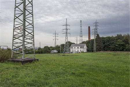 House in Field Beneath High Voltage Power Lines, Charleroi, Wallonia, Belgium Stock Photo - Rights-Managed, Code: 700-06452137