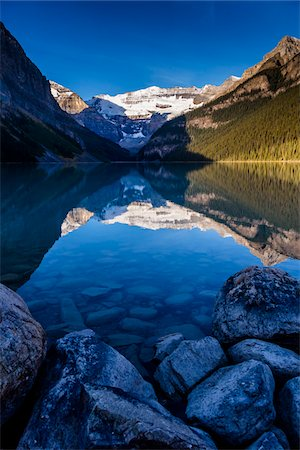 snow capped - Lake Louise at Dawn, Banff National Park, Alberta, Canada Stock Photo - Rights-Managed, Code: 700-06465430