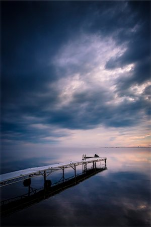 sky - Dock on Still Lake with Storm Clouds Overhead, King Bay, Point Au Fer, Champlain, New York State, USA Stock Photo - Rights-Managed, Code: 700-06465581