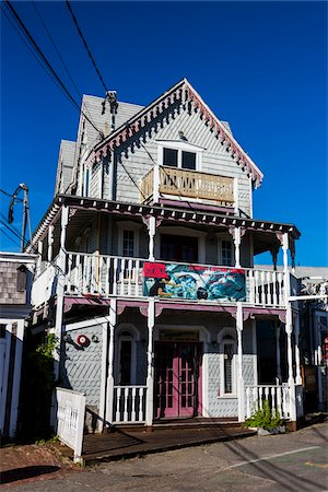 quaint house - House Exterior with Shark Tour Banner on Balcony, Wesleyan Grove, Camp Meeting Association Historical Area, Oak Bluffs, Martha's Vineyard, Massachusetts, USA Stock Photo - Rights-Managed, Code: 700-06465749